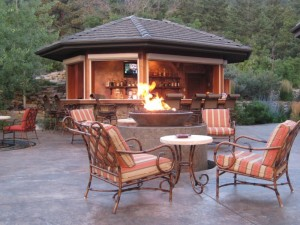 Fire bowl and water feature in backyard patio