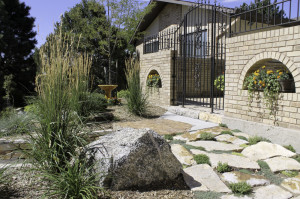 Jazz up your planting beds by adding landscape boulders