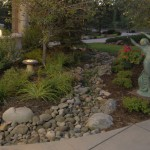 Dry creek bed, statue, and night lighting