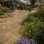 Lush landscape plantings in backyard courtyard