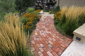Concrete is the most formal and expensive walkway surface
