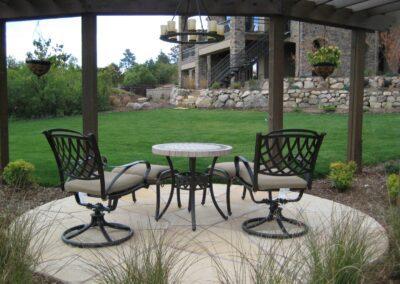 Flagstone | Pergola | Lawn | Boulder Wall
