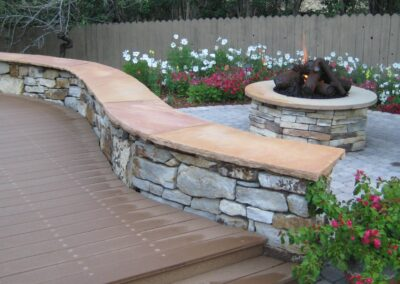 Siloam Stone Seating Wall | Fire Pit | Metal Logs | Plantings | Pavers