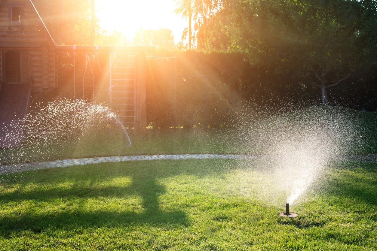 Sunset over Colorado Springs sprinkler system watering the yard